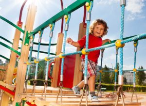 Child playing on outdoor play center