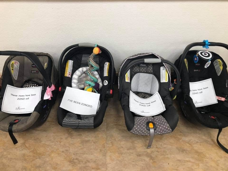 Car seats cleaned by a ZONO Disinfecting & Sanitizing Cabinet