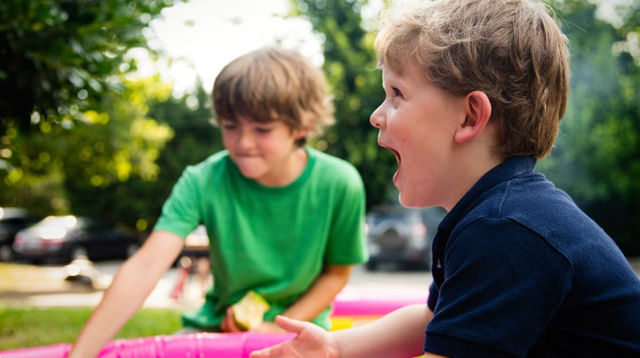Two boys playing outside