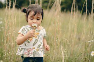 Little girl playing in field