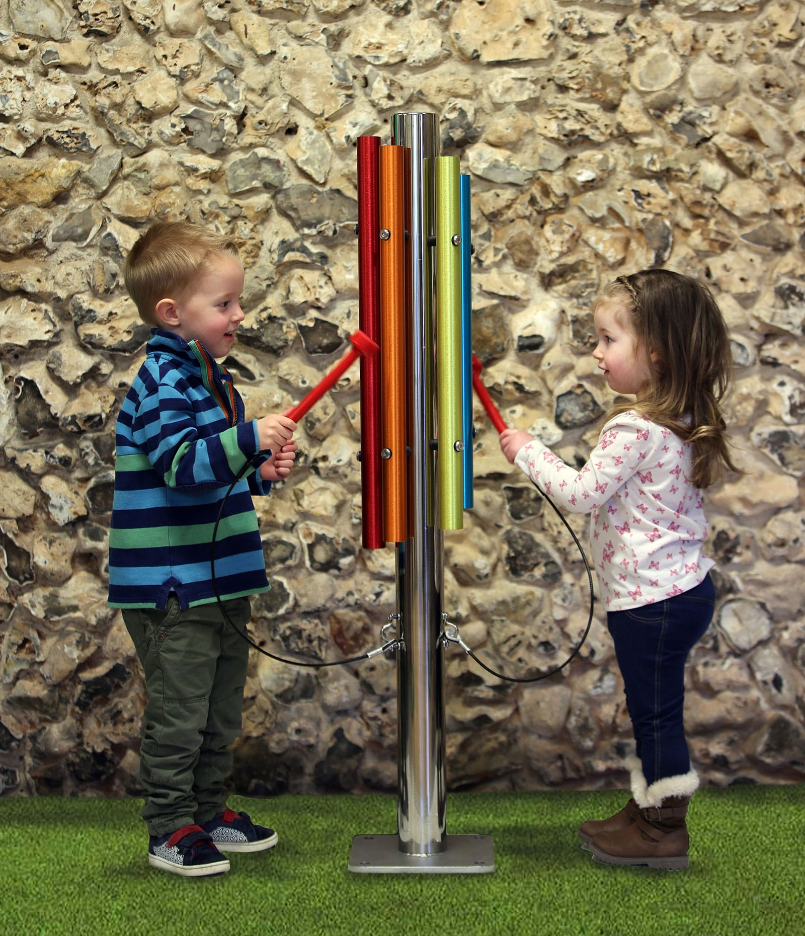 kids playing with rainbow chime post