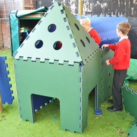 Children playing with Playspace Design Poddely house toy