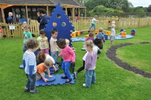 Children playing with Poddely set outdoors