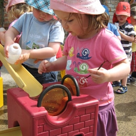 Little girl playing with Playspace Design Poddely water-channeling toys