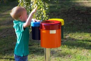 Young boy playing bongos in Music Garden
