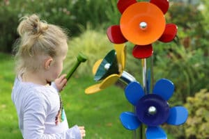 Young girl playing flowers in Music Garden