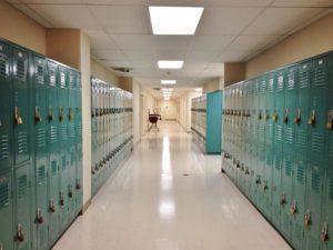 rows of lockers in a school hallway